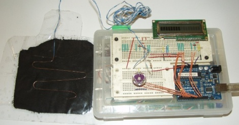 Arduino on breadboard with 16x1 LCD and RGB LED for debugging, hooked up to home-made pressure sensor.